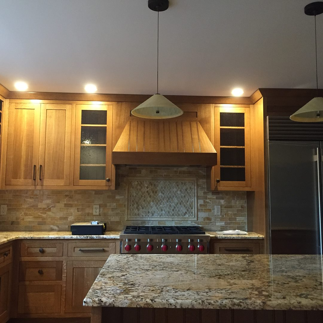 Kitchen with custom hood enclosure